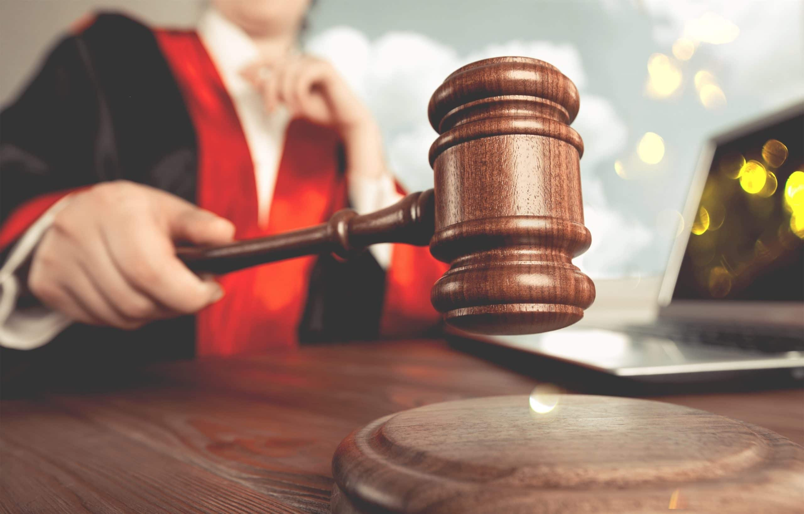 appealing spousal support ruling concept. Man holds gavel judge with lawyer